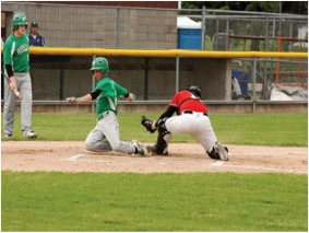 Photo of Legion Baseball Player Sliding In to Home and catcher taging
