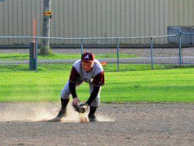 Junior Leagle Baseball Player Fielding a ground ball