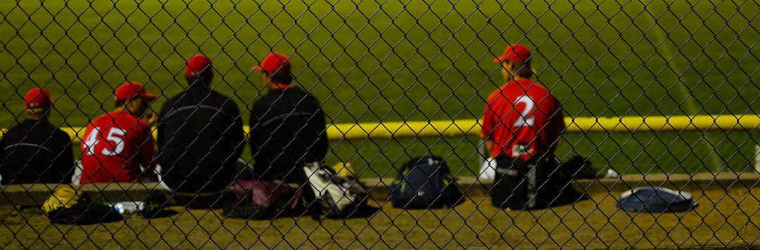 Photo of Kids at baseball field at night